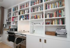 Bespoke white home office desk with book shelving above.