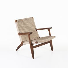 CH25 Lounge Chair - Walnut - This mid century modern lounge chair was originally designed by famed designer Hans Wegner. Like his other designs, this wooden arm chair is crafted with expert precision with modern danish lines. The seat and back are made form a corded rattan material that adds to the comfort and design.  http://www.franceandson.com/mid-century-modern-ch25-lounge-chair-walnut.html