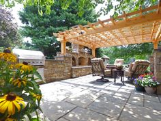Flagstone Patio with Pergola and Fireplace installed in Lancaster, PA