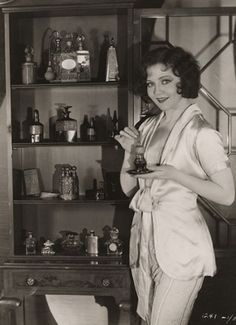 Nancy Carroll with perfume collection.