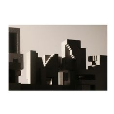 A large-scale photograph print by Montreal-based artist David Umemoto. This artwork exemplifies Umemoto's signature approach, informed by the Brutalist movement and architects such as Le Corbusier. Using his concrete sculptures as a subject, this print is grand in scale. Printed on archival cold-pressed cotton paper. Ships unframed.