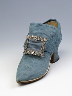 Pair of shoes, British, ca.1740s. Blue silk damask shoes with latchets, paste and metal buckles in situ | V The Collections