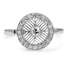 Old European cut diamond surrounded by intricate latticework. Twenty single cut diamond accents create an encompassing circle in this white gold Art Deco ring (approx. 0.30 total carat weight).