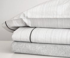 AREA Inc. THIN graphite. Graphite lines on a white soft cotton percale duvet cover, sheets, and cases.