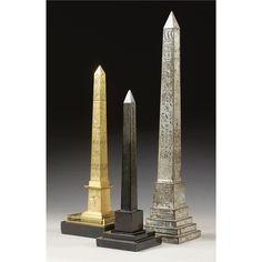 """An English silvered metal model of Cleopatra's needle on a stepped square base with an elaborate inscription ; a black marble model of the obelisk at Heliopolis, inscribed on the front """"the one of the scriptures erected by Osortseen I,' the earliest of the pharaoh whose name is found on the hieroglyphics& a French gilt-bronze model of Louis-Philippe's obelisk, 19th century, from the Place de la Concorde. 1th: 58cm. high; 1ft. 10¾in.- 2nd: 37cm high; 1ft. 2½in.- 3d: obelisk 44cm. high; 1ft…"""