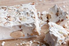 A nougat made of honey, sugar and egg whites with toasted almonds, torrone is the most popular Italian candy and is made throughout all of Italy. Learn more about this beloved Italian nougat that inspired many of the commercial candy bars we know today. Italian Desserts, Italian Recipes, Torrone Recipe, Italian Nougat Recipe, Almond Nougat Recipe, Italian Candy, Food Club, Toasted Almonds, Junk Journal
