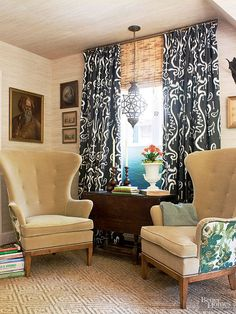 This den displays dueling designs at work: The old-fashioned dignity of European wingback chairs, a dark wood desk, and gilt-frame portraits on the wall are combined with the more dazzling decor of the tropics -- most notably in a brass and glass lantern, thegrass-cloth wallcovering, the black ikat curtains, and fabric accents bursting with greenery. The play between the opposing styles is like a Hemingway novel: It speaks English but tells tales of exotic locales.
