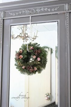 FRENCH COUNTRY COTTAGE: A simple wreath, adorned with dried roses and pine cones