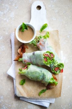 """BLT Spring Rolls  Ingredients:    fresh lettuce, chopped  2 medium tomatoes (seeded and sliced 1/4"""" thick)  6 pieces of bacon, fried  fresh basil, mint or other herbs  rice paper    Sesame-Soy Dipping Sauce  1/2 c (120ml) Soy Sauce  1 T (15g) Mayonnaise  1 t (5ml) fresh Lime Juice  1 t (5ml) Sesa"""