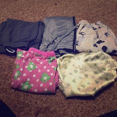 5 pairs of Pajama Pants and Sweat Pants 1- pink with frogs. Size L - fits a M                        2- yellow silk with frogs. Size S - fits a S and M comfortably.                                                                     3- Dark Greg sweats. Size S.                                     4- Grey with Black stripes on side - size M.           5- yellow with penguins - M Intimates & Sleepwear Pajamas