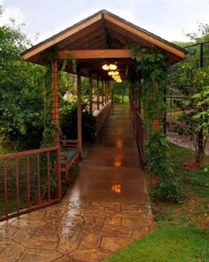 Covered Walkway Between Detached Garage Guesthouse And