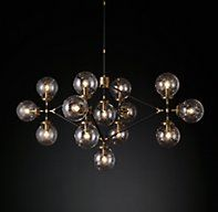 RH Modern's Bistro Globe Clear Glass Lattice Chandelier:While our chandelier's glass bulbs are reminiscent of classic café lighting, its conjoined diamond shape is pure 1960s-modern. A trio of glass globes extends from the frame's end points for ambient effect.