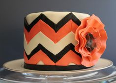 Orange and Black Chevron Cake for Fall, with Fondant Flower.  Underneath the marshmallow fondant was four layers of double chocolate cake filled with pumpkin-spice swiss meringue buttercream  -- SomersetCakes.com