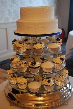 2 Tier wedding cake with cupcakes.. Shhh don't tell daddy. :-)