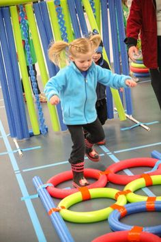 Set up a superhero training day with pool noodle obstacles!