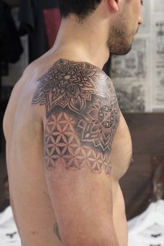 Artist: Woodfarm Tattoo Subject: Mandala with Flower of Life Tattoo Style: Dotwork, Blackwork, Geometric, Sacred Geometry Tags: Awesome, Placement, Shoulder Cheltenham's prestigious tattoo studio TOKYOTATTOO