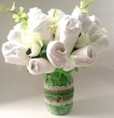 A personal favorite from my Etsy shop https://www.etsy.com/listing/280854144/diaper-bouquet-diaper-cake-centerpiece