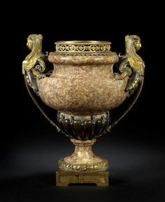 An Italian late 19th century Egyptian Revival gilt and patinated bronze mounted Brocatelle d'Espagne marble urn