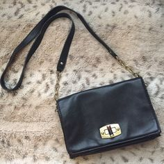 Leather Crossbody Black leather with tortoise shell clasp. Some tarnish on gold plate. Defects pictured. Wear on other side as well. Not AA. Listed for exposure. American Apparel Bags Crossbody Bags