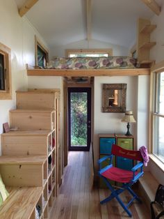 bathroom, mudroom, above is sleeping loft, stair cubbies and across is desk space, full kitchen on opposite end
