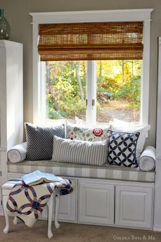window seat made from 2 upper cabinets in master bedroom via www.goldenboysandme.com