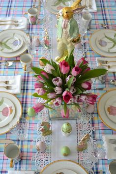 Easter table with bunnies, eggs, and tulips in jelly bean vase centerpiece! | homeiswheretheboatis.net