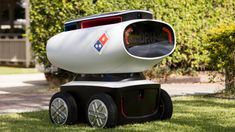 Battery-powered pizzabot has 12-mile range; customers access pizza with a code.