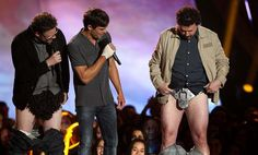 Seth Rogen, Zac Efron and Danny McBride present the award for best shirtless performance. (Photo by Matt Sayles/Invision)
