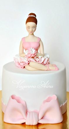 When I first saw this I thought it was a bride cake (the upper half body of the ballerina and the cake below is the 'skirt') :)