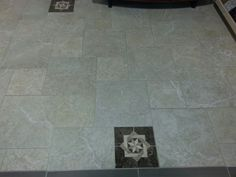 This the Grandeur Rich Honey by Florida Tile done in a pin wheel pattern