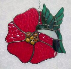 Stained glass Hummingbird on red hibiscus - best seller [humbirdonredhibiscus] - $65.00 : Glass Moose Cart, handcrafted glass, beads/supplies, jewelry, wood & metal art, signs