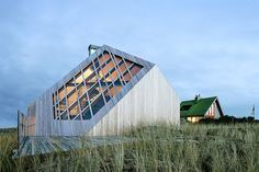 Planted in the sands of the Dutch island of Terschelling, the Dune House is designed to capture the unique character of its natural environment. The abstract roofline is a play on the form of its rugged surroundings and is angled...