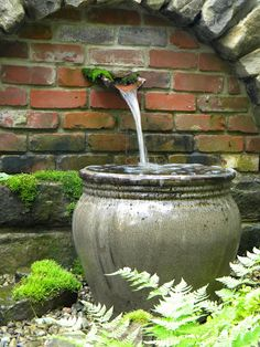 The brick would tie into the rill edges and the pergola floor. The Vase could be sitting in the rill overflowing.