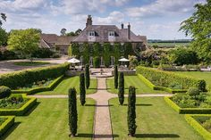 Beyond an elegant tree-lined drive, Holt Manor reigns supreme over manicured lawns and 93 acres of picturesque countryside. Dating from the 17th century, with an ivy-covered stone façade and slate roof, the home is located just three miles from the historic town of Bradford on Avon.