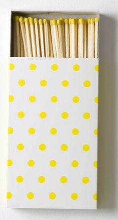 Adorable yellow polka dotted match book.