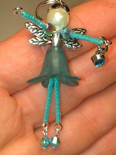 beaded people - Teal fairy holding a little gem :)fairy image onlyThis Pin was discovered by Ash Wire Jewelry, Jewelry Crafts, Beaded Jewelry, Jewelery, Jewelry Necklaces, Beaded Angels, Beaded Ornaments, Bijoux Diy, Christmas Jewelry