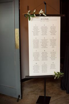 beautiful scroll seating chart accented with eucalyptus:  Bridal Bliss Wedding