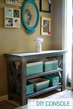 DIY-Make a Custom Console Table — Saved By Love Creations. This would be great for the kids to put their school stuff on during the weekdays. (Place on side wall near front door.)