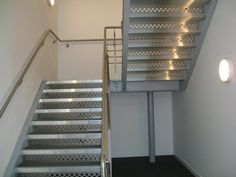 Mild steel staircase powder coated with stainless steel balustrade and risers infills