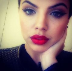 cat eye liner and red lipstick . classy makeup