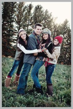 Art cute family of 4 christmas card photo with candy canes photography
