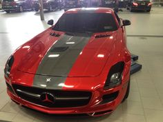Red Chrome wrapped Mercedes-Benz SLS  wrapped by:  http://www.phenomenalvinyl.com