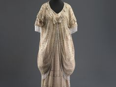 Woman's outfit Alexandria (?), Egypt, 1920s  Cotton tulle, silver tinsel embroidery  Purchased through the gift of Dr. Willy and Charlotte Reber, Valbella, Switzerland  ............... Charleston on the Nile In the nineteenth and early-twentieth centuries Alexandria was a bustling mercantile center and international hub. Fittingly, its streets featured the highest of European fashion. The Israel Museum, Jerusalem | Dress Codes Revealing the Jewish Wardrobe