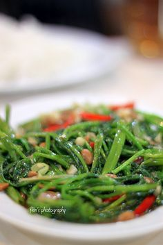 Kangkung. Indonesian spinach. I know, who likes spinach? Well, anyone that tastes this kind. SO GOOD. #Indonesian recipes #Indonesian cuisine #Asian recipes http://indostyles.com/