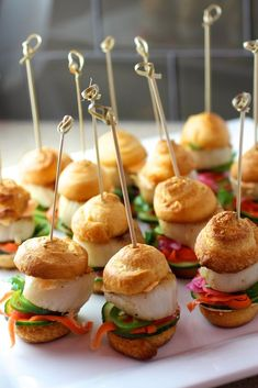 "Scallop ""Banh Mi"" Sliders  Grilled Jumbo Sea Scallop on a Mini Crescent Bun Pickled Carrot, Radish, and Red Onion Fresh Cucumber, Jalapeño, and Cilantro Sriracha Mayonnaise"