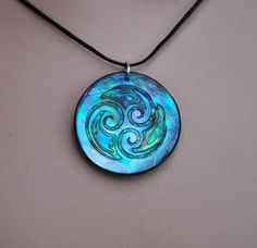 One of a kind hand engraved trinity Paua shell pendant. The trinity koru symbolizes family & a loving union. It also represents the connection between Earth, Sea & Sky. Body, mind & spirit. The shell is reflective so the colors change depending on the light, this is the actual piece you will receive. Moana is the Maori word for Sea, this design can symbolize the swirling of the Ocean currents. A lovely pendant for an Ocean lover. New Zealand Paua shell is a southern Abalone known...