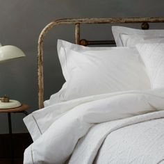 bedspread, and I love the ladder stitch pillows etc.... duvet & pillow warehouse