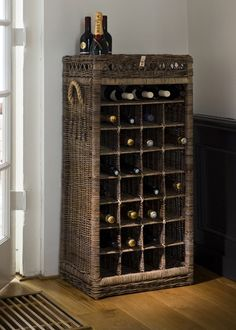 Rustic Rattan Wine Rack 28 Bottles Hand-woven wine rack, made from grey dyed cane, for twenty-eight bottles of wine. Santé! Dimensions (in cm): 50 x 108 x 37 ( x x ) Article number: 806200 Price: € 419,00