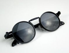 Unisex round metal unisex sunglasses Goth Steampunk style. Heavy sturdy frame made in high quality materials. Frame material is stainless steel. Lenses are PC with UV 400 sun protection and also polarized. They dont make such quality these days. Limited number in stock.  Suitable for most faces.