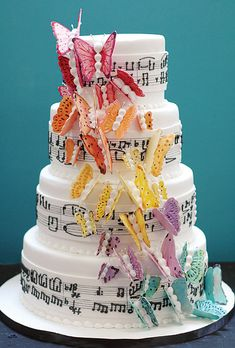 Beautiful! The notes alone are so fun but then you add the butterflies! Love the pop of color!
